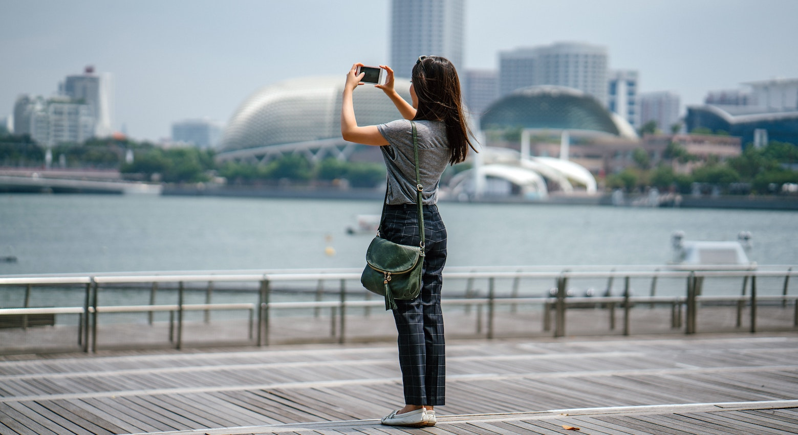 woman photographs bay