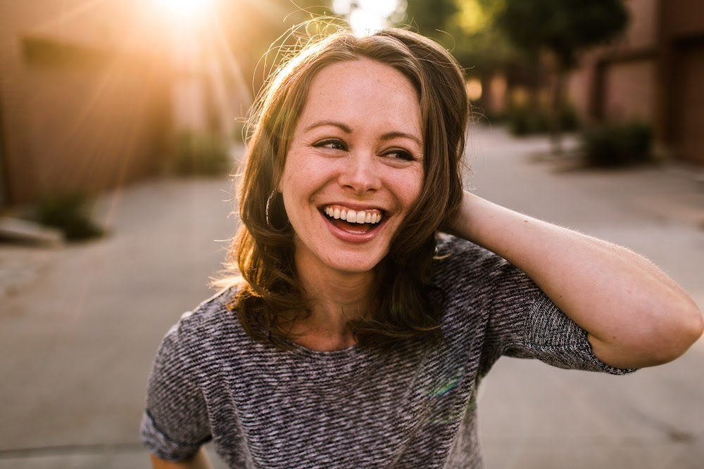smiling portrait with sunshine