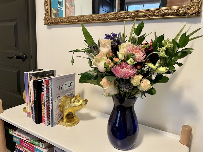 bouquet on bookshelf